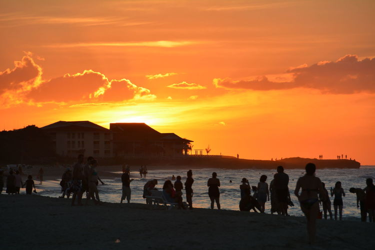 People on beach at sunset
