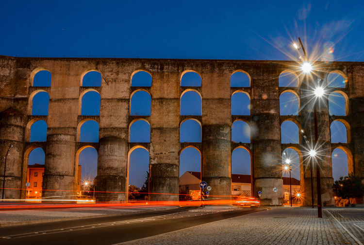Aqueduct Cars Elvas Light Painting With Light Portugal Alentejo Arch Architecture Captured City Clear Sky Illuminated Movementcaptured Night No People Outdoors Road Sky Sunset Stories From The City