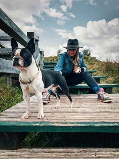 Day Two People Outdoors Sky Full Length Casual Clothing Dog Lifestyles Friendship Adults Only Togetherness Pets Real People Cloud - Sky Leisure Activity Adult Bonding Sitting Young Adult People