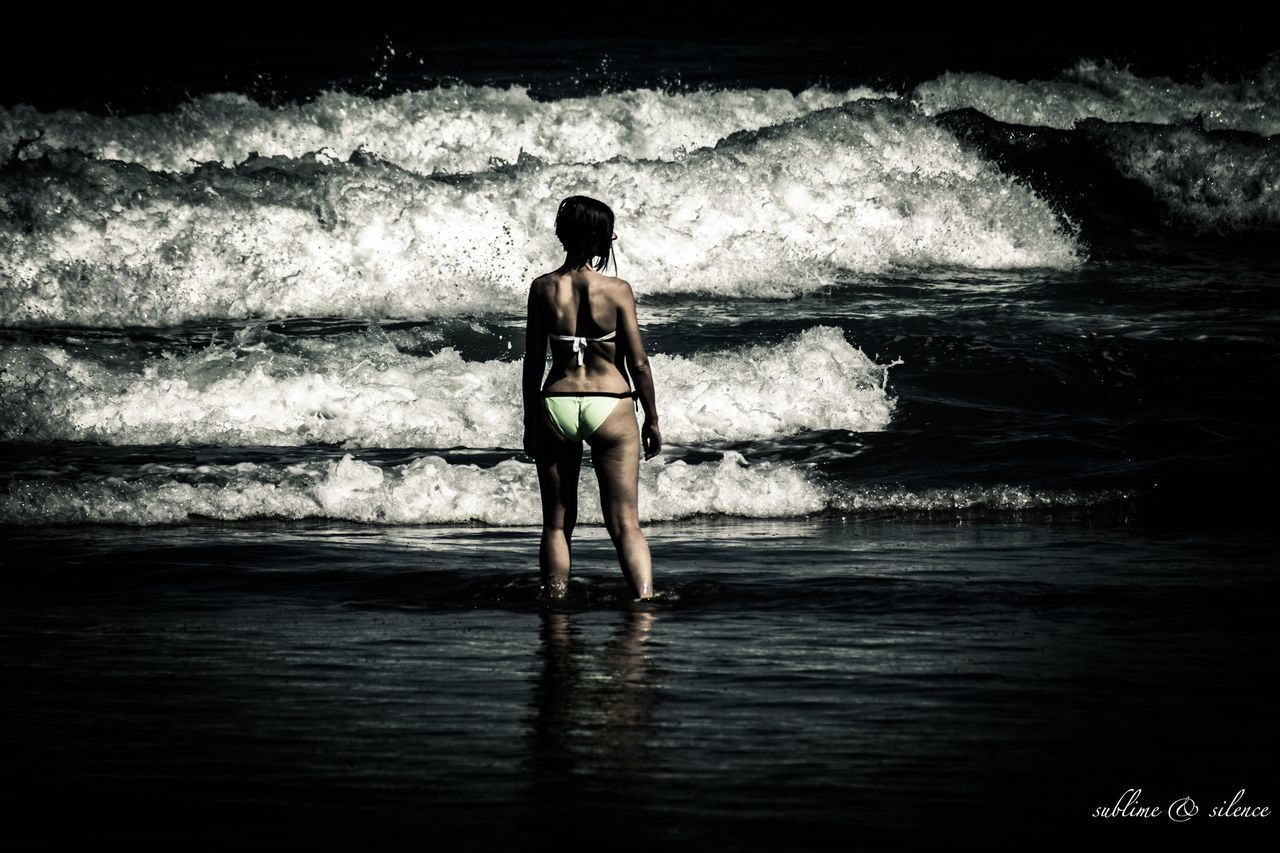 sea, wave, one person, beach, full length, rear view, water, one woman only, beauty, young adult, standing, nature, adults only, only women, adult, vacations, people, one young woman only, day, horizon over water, outdoors, ankle deep in water, beauty in nature, women, beautiful woman, young women, sky