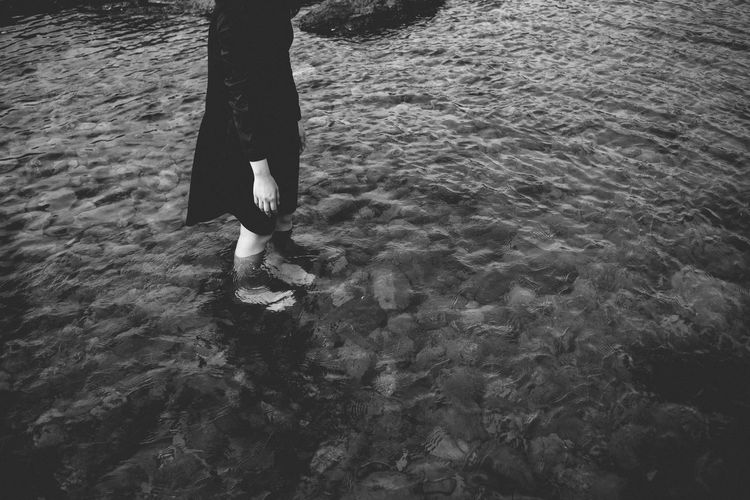 Low Section Of Girl Standing In Lake