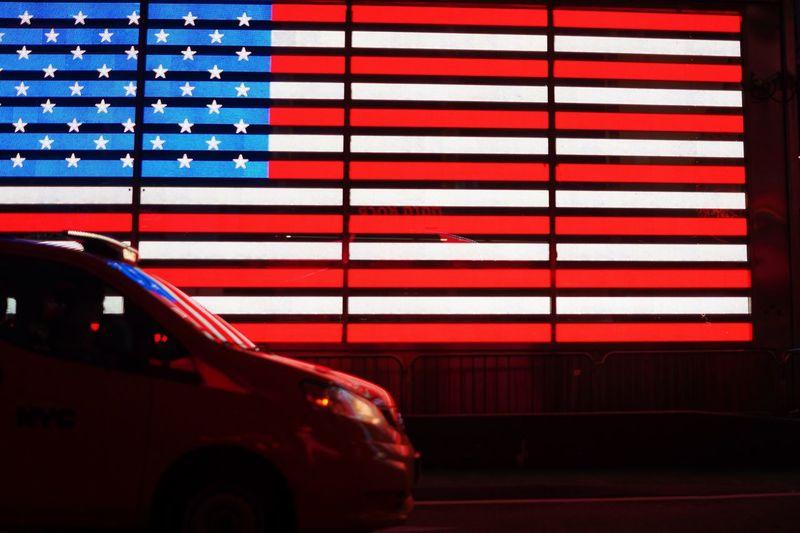 Close-Up Of Car Against Illuminated Flag