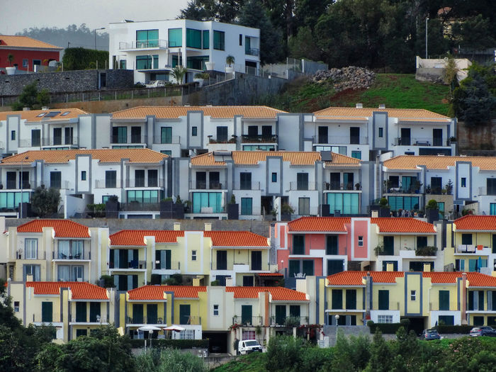 Row of houses. Building Exterior Built Structure Architecture Residential District Building City House No People Multi Colored Nature Day Outdoors Plant Window Town Tree City Life Apartment Row House Houses TOWNSCAPE Row Of Houses Residential Building Residential Structure Buildings Village