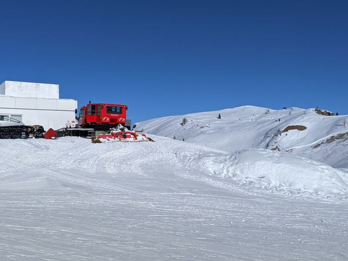 Snow on snowcapped mountain against clear blue sky
