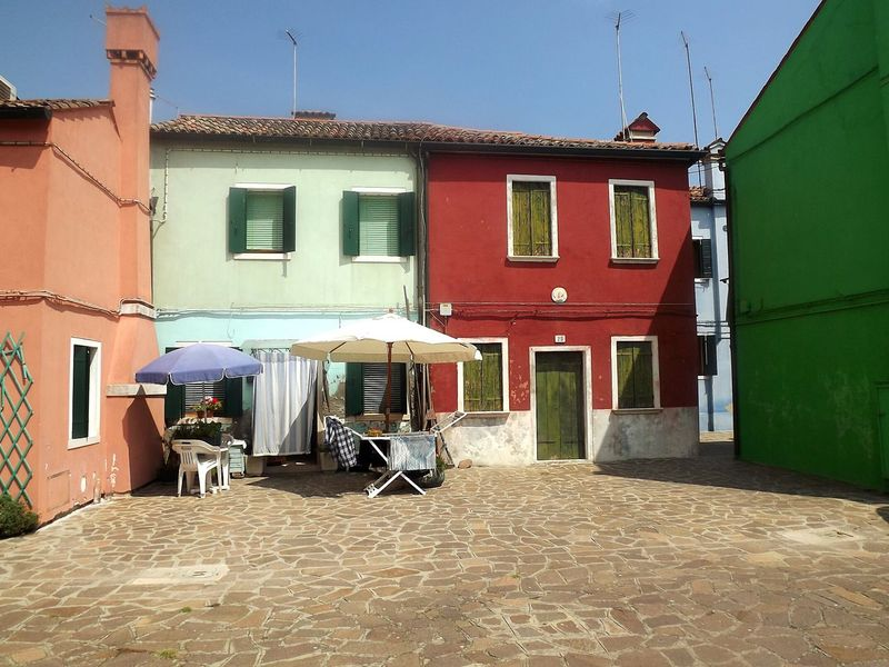 Burano Venezia Tranquil Scene No People Architecture Outdoors House Facades Multicolor Houses Colorful Italia Italy Bella Italia Beauty Of Italy Closed Windows Closed Doors Drying Rack Chairs Neighborhood Map Live For The Story Colour Your Horizn Adventures In The City