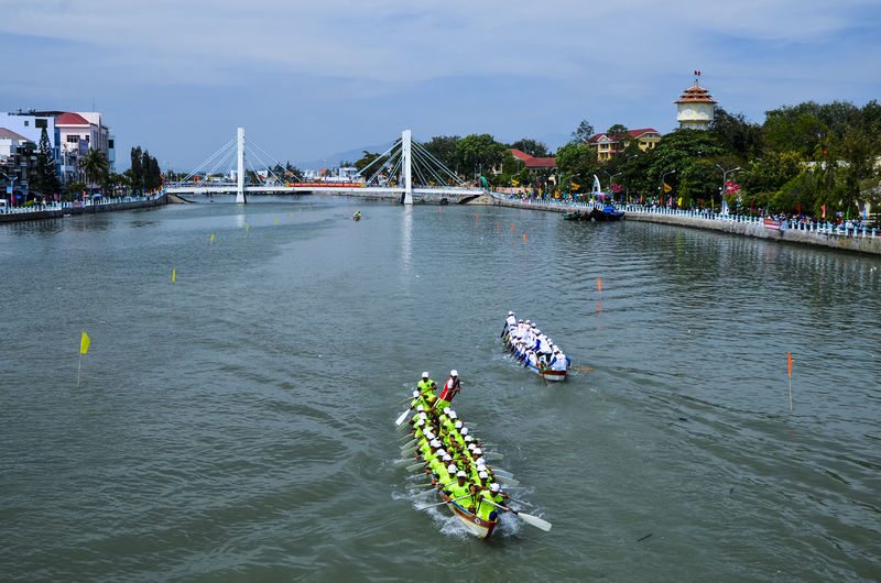 Ca Ty river boat racing Architecture Boat Boat Contest Bridge Bridge - Man Made Structure Built Structure Ca Ty River City City Life Cloud Cultural Festival Day Famous Place Floating On Water Nautical Vessel People People Watching Peoples River Sky Tourist Travel Unite  Water Waterfront
