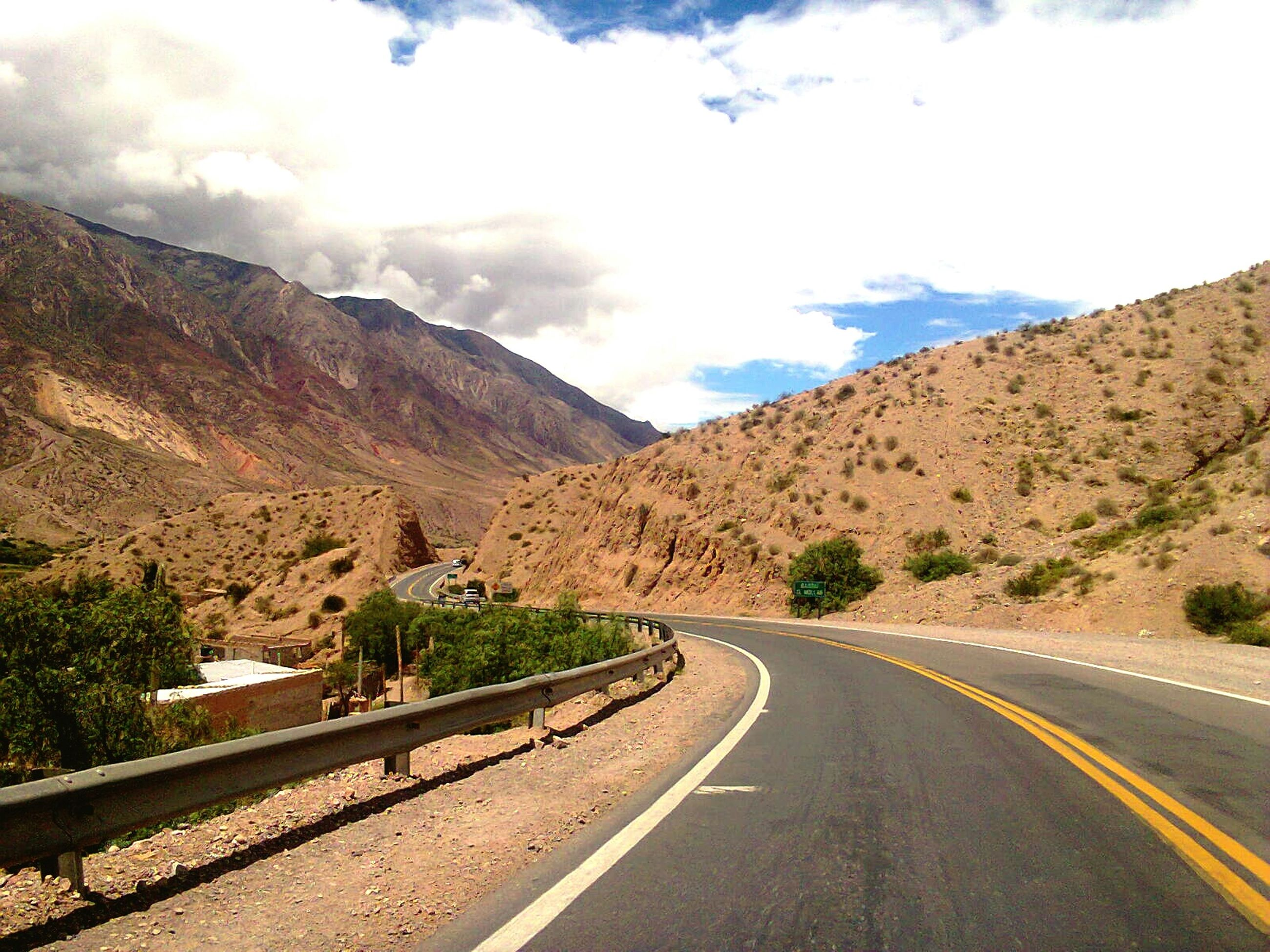 road, the way forward, transportation, mountain, road marking, sky, diminishing perspective, country road, vanishing point, mountain range, cloud - sky, empty road, asphalt, landscape, tranquil scene, cloud, street, nature, empty, tranquility