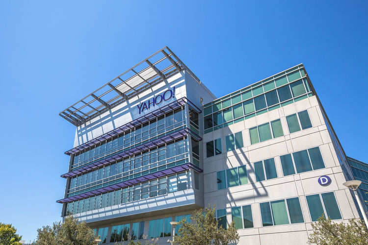 Sunnyvale, California, United States - August 15, 2016: Yahoo Headquarters facade building. Yahoo is a multinational technology company that is known for its web portal. Company Multinational Sunnyvale USA United States Yahooweather America Architecture Blue Building Building Exterior Built Structure City Clear Sky Day Headquarters Hq Low Angle View Modern No People Outdoors Search Engine Sky Street Sunnyvale Street Yahoo