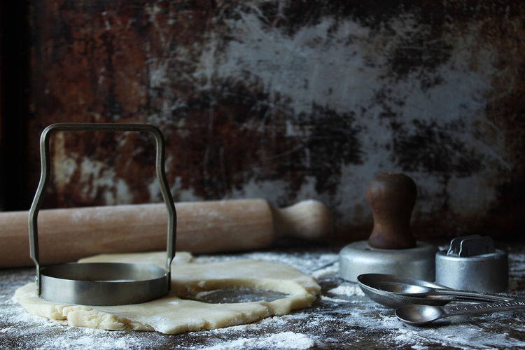 Making cookies the old fashioned way Cookies Cookie Making Cookie Dough Cookie Cutters Kitchen Utensil Rustic Dark Baking Baking Cookies Rolling Pin Vintage Retro Messy Making Indoors  Food And Drink No People Still Life Food Household Equipment Preparation  Selective Focus Copy Space