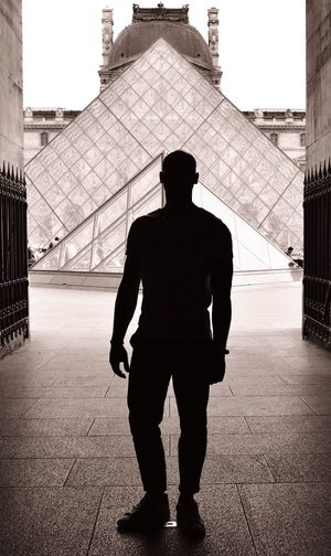 Full length rear view of silhouette man against sky