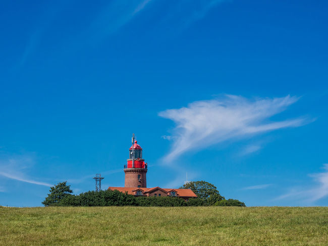 Lighthouse in Bastorf, Germany Agriculture Architecture Bastorf Beauty In Nature Blue Building Exterior Bük Cloud - Sky Day Kühlungsborn Landmark Landscape Lighthouse Meadow Nature No People Outdoors Sky Travel Destinations Tree