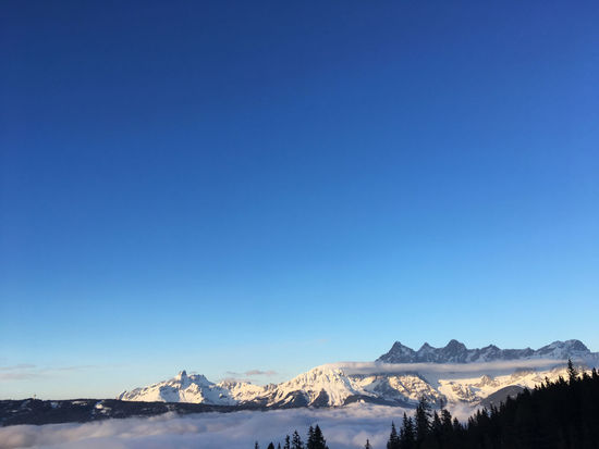 Great view over the clouds at the peaks of Dachstein Glacier Dachstein Fageralm Forstau Wintersport Beauty Blue Copy Space Day Frozen Landscape Mountain Mountain Range Nature No People Outdoors Peak Scenics Ski Amade Sky Skyscraper Snow Snowcapped Mountain Tranquility Winter Shades Of Winter Go Higher