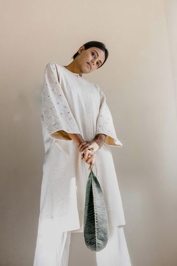 White Portrait Sustainability Fashion Photography One Person Indoors  Clothing Adult Lifestyles Young Adult Women Standing Real People Hairstyle Dress Wall - Building Feature White Color Bathrobe Beautiful Woman Robe Mid Adult Fashion