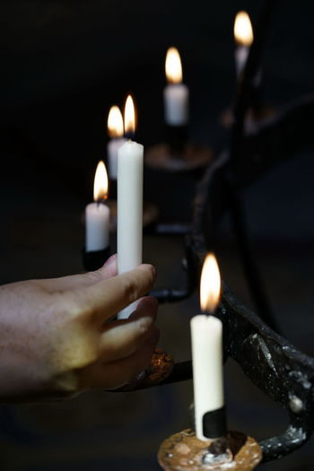 Burning Candle Candleholder Close-up Dark Finger Fire Fire - Natural Phenomenon Flame Glowing Hand Heat - Temperature Holding Human Body Part Human Hand Illuminated Indoors  Lighting Equipment Melting Nature One Person Religion Wax