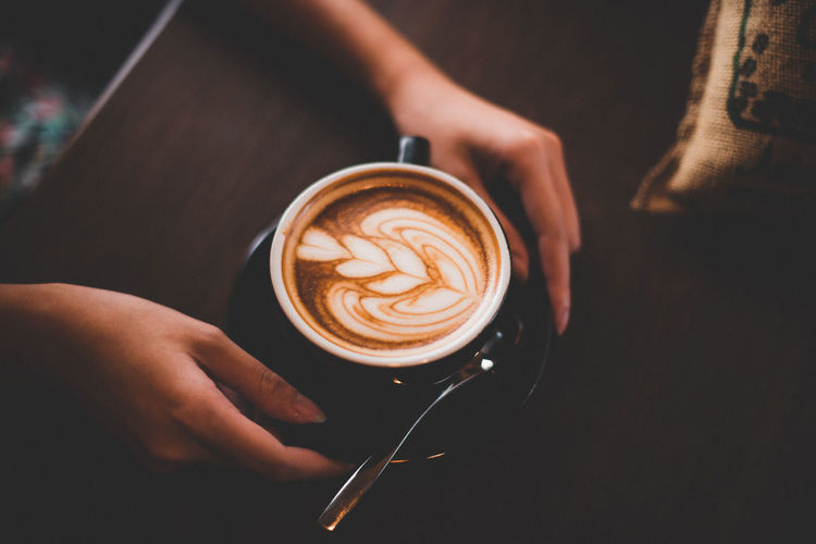 A cup a day Barista Cappuccino Coffee Coffee - Drink Coffee Cup Creativity Crockery Cup Drink Food And Drink Froth Art Frothy Drink Hand Holding Hot Drink Human Body Part Human Hand Indoors  Latte Mug One Person Real People Refreshment