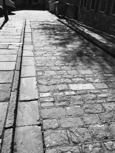 Black & White Black And White Blackandwhite Shadow Stone Streets Empty Street Empty Road Cobblestone Streets Cobblestone The Way Forward Day Outdoors No People