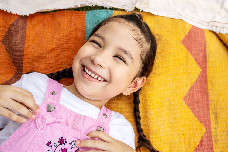 Portrait of a smiling girl on bed