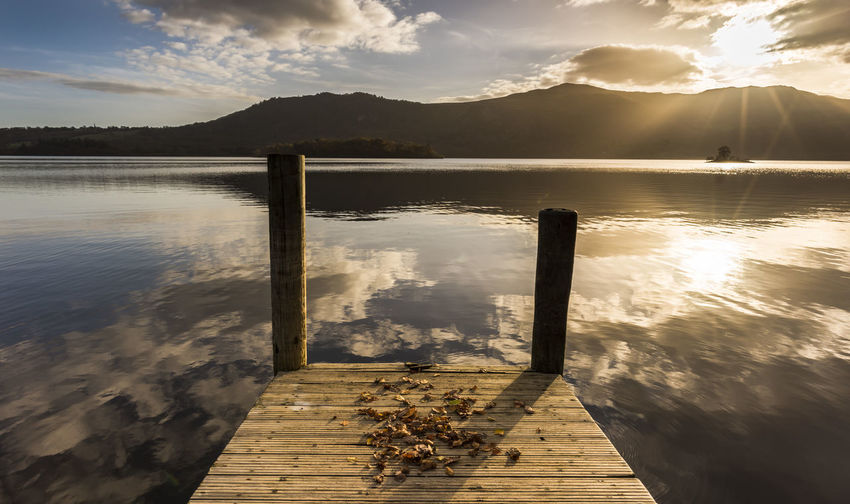 Golden hour on a beautiful Autumnal morning Autumn Colors Cumbria England UK Gold Travel Beauty In Nature Cloud - Sky Day Idyllic Jetty View Lake Mountain Mountain Range Nature No People Outdoors Reflection Scenics Seasons Sky Sunlight Sunrise Tranquil Scene Tranquility Water
