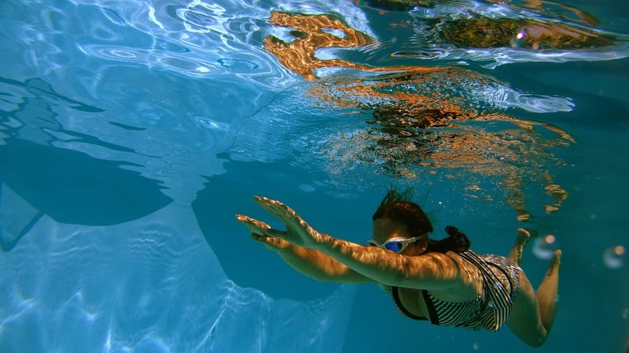 Full length of woman swimming in water