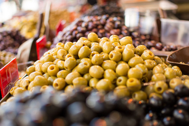 Close-up of olives for sale at market stall