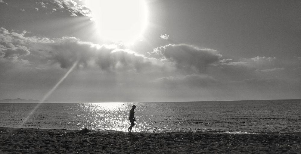A Walk on the beach in Santorini perisa Horizon Over Water Standing Sunlight Tranquility Scenics Nature SilhouettePerissa Sunlight Fujifilm Travel Destinations Santorini Scene The Week On EyeEm EyeEm Masterclass Beach Life Santorini, Greece