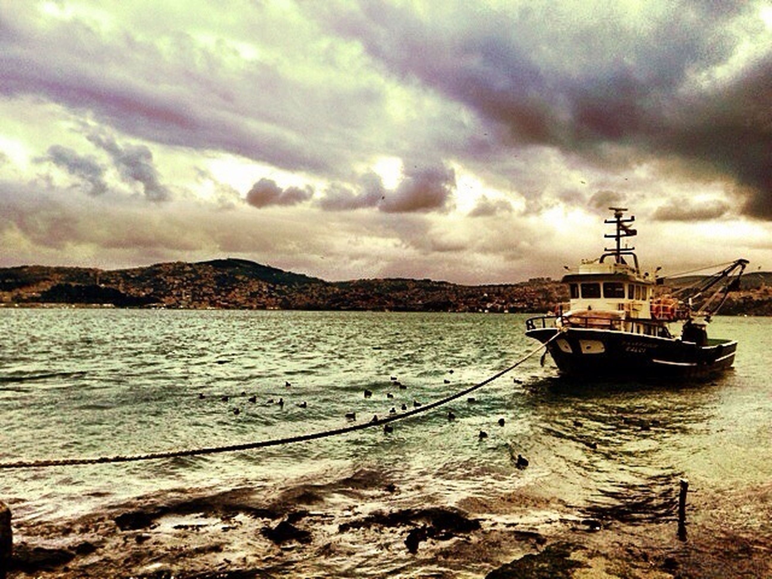 nautical vessel, water, sky, cloud - sky, transportation, boat, mode of transport, cloudy, moored, mountain, sea, cloud, tranquility, scenics, tranquil scene, beauty in nature, overcast, nature, weather, mast
