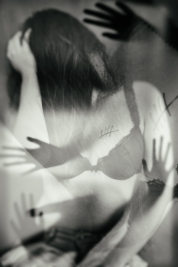 Double exposure image of woman in lingerie with hands