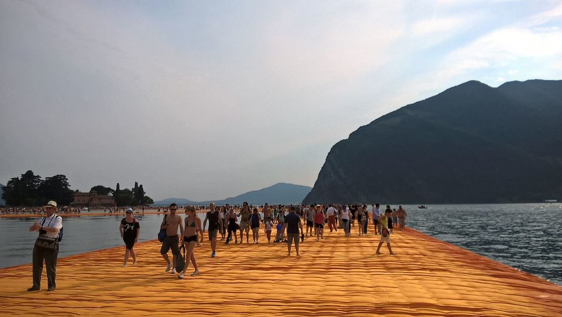 Beauty In Nature Cloud - Sky Day Floating Piers Group Of People Idyllic Lifestyles Medium Group Of People Mixed Age Range Mountain Mountain Range Nature Non-urban Scene Outdoors Remote Scenics Sky The Way Forward Tourism Tourist Tranquil Scene Tranquility Travel Destinations Vacations Water