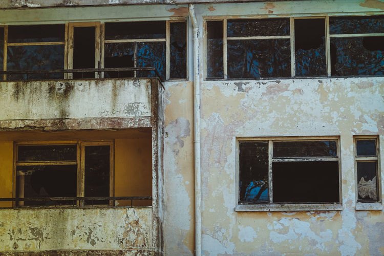 Abandoned Architecture Bad Condition Building Building Exterior Built Structure Damaged Day Decline Deterioration House Low Angle View No People Obsolete Old Outdoors Residential District Ruined Run-down Weathered Window Window Frame