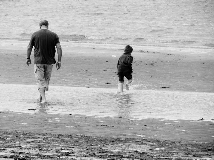 On the beach Blackandwhite People On The Beach