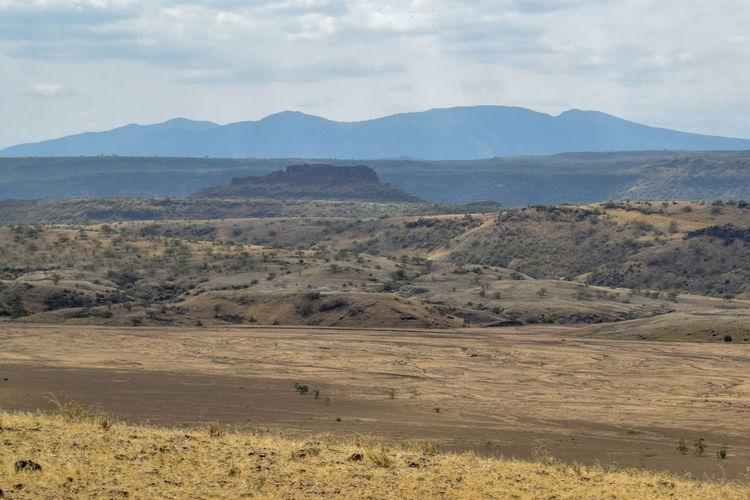 Arid landscape against a mountain background, lake magadi, rift valley, kenya