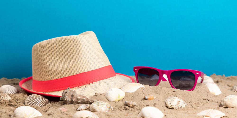 Beach Blue Blue Background Close-up Copy Space Day Fashion Glasses Hat Holiday Land Nature No People Personal Accessory Red Sand Sea Shell Still Life Summer Sun Hat Sunglasses Sunlight