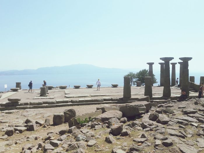 Assos (Temple of Athena) Temple Travel Tourism çanakkale Assos Athena Tapınağı Temple Of Athena Water Sea Beach Sand Clear Sky Bird Shadow Sunlight Sunny Blue Gravestone International Landmark Famous Place Tourist Attraction  Visiting Travel Destinations