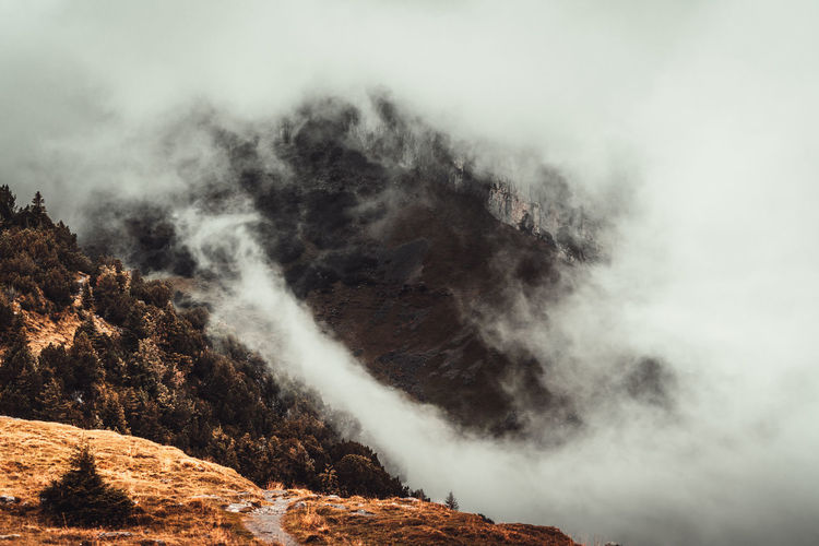 Beauty In Nature Scenics - Nature Mountain Non-urban Scene No People Tranquility Nature Fog Smoke - Physical Structure Sky Cloud - Sky Tranquil Scene Power In Nature Power Environment Day Motion Rock Geology Outdoors Foggy Foggy Day Foggy Morning Mountain Range