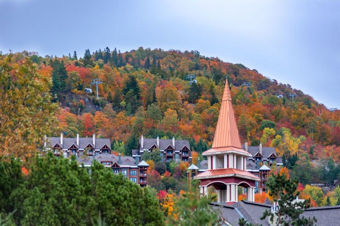 Fall Beauty Fall Colors Mont Tremblant, Qc Architecture Autumn Building Building Exterior Built Structure Change City Day House Nature No People Outdoors Place Of Worship Plant Religion Residential District Sky Spire  Travel Destinations Tree