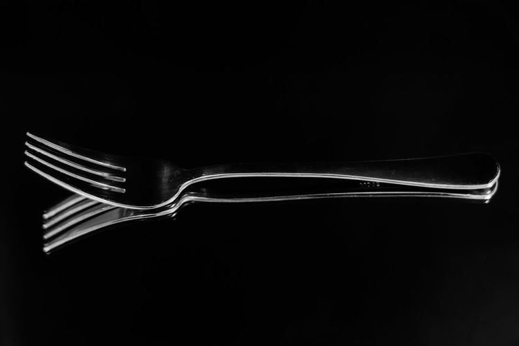 Close-up of spoon over black background