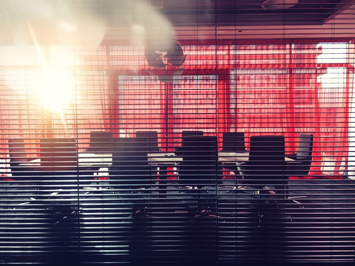 Sunlight falling on conference table in office