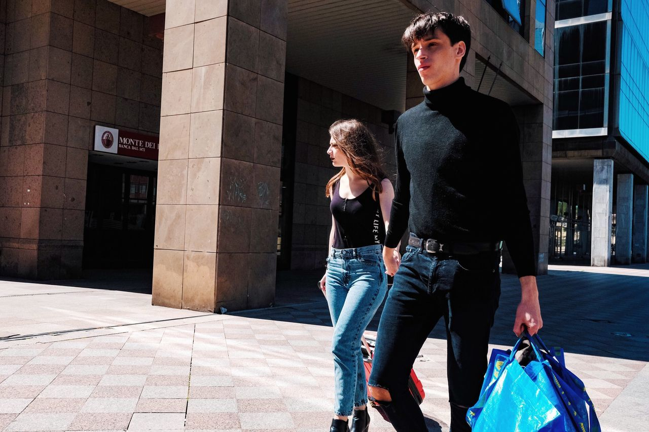architecture, two people, real people, casual clothing, young adult, togetherness, building exterior, city, love, lifestyles, built structure, leisure activity, emotion, bonding, women, adult, young men, people, day, walking, positive emotion, outdoors, couple - relationship