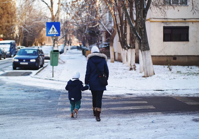 Baby it's still cold outside! Winter Casual Clothing Warm Clothing Cold Temperature Full Length Snow Walking Road Sign Details Of My Life Made In Romania Found On The Roll Fresh On Eyeem  Winter Wonderland City Life Vscocam My Favorite Photo Wintertime Mother And Son Motherhood Winter Day Christmas Spirit Snow Day City Street Winter In The City Snow ❄
