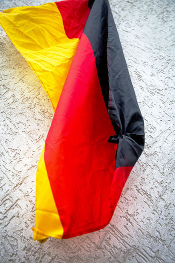 Crumpled German Flag Germany🇩🇪 Wall Black Color Close-up Day Flag Focus On Foreground High Angle View Multi Colored No People Outdoors Patriotism Pattern Red Textile Wind Yellow