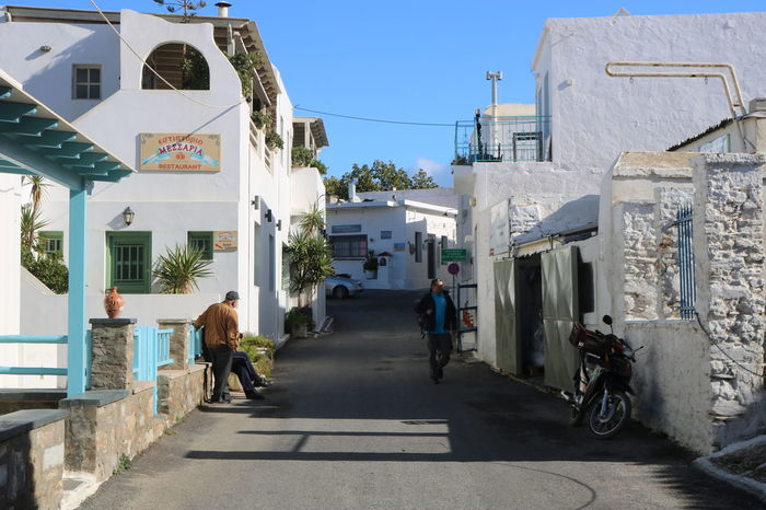 street of Kythnos Adult Adults Only Architecture Building Exterior City Clear Sky Day Full Length Mature Adult One Person Outdoors People Rear View Shadow Sky Sunlight The Way Forward Tree Urban Road