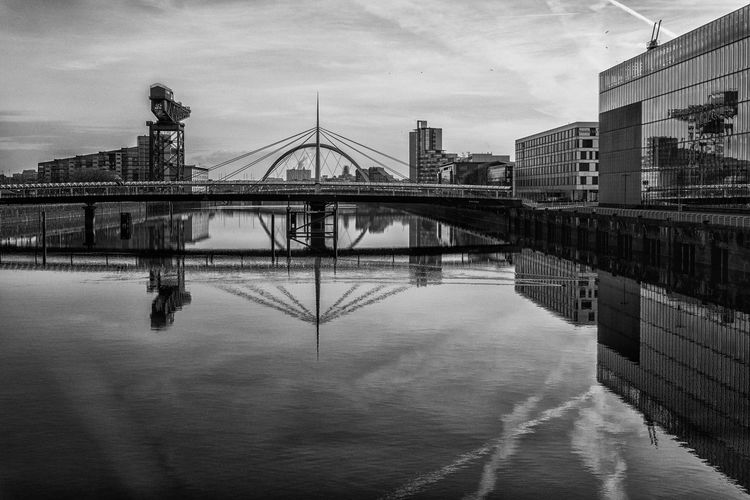 A Bridge Through A Bridge Architecture Bell's Bridge Built Structure Clyde Arc Connection Engineering Horizontal Symmetry Pacific Quay Reflection River Clyde Symmetry Waterfront
