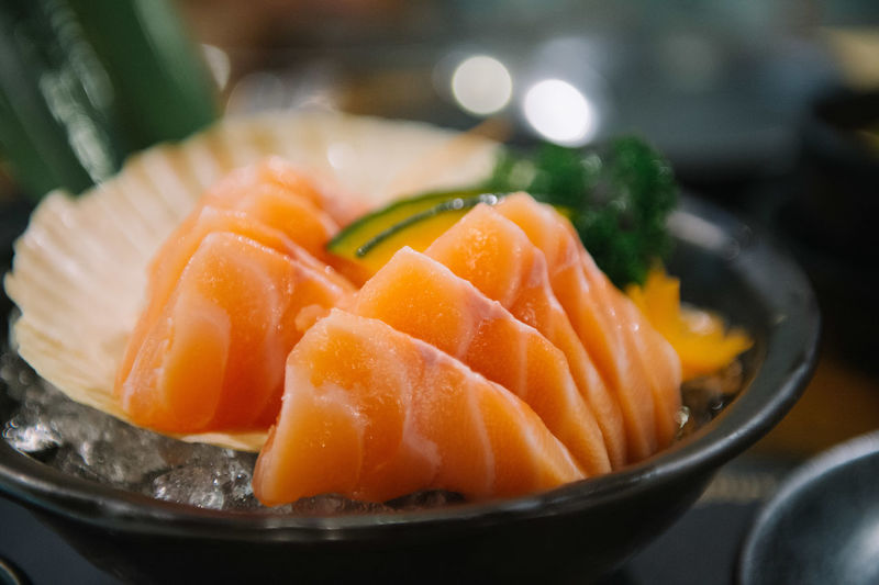 Fresh salmon slice or salmon sashimi Japanese style food. Background Beautiful Bright Closeup Cooking Cuisine Culture Delicious Dinner Eating Fat Fish Food Fresh Freshness Gourmet Green Health Healthy Ice Ingredient Japan Japanese  Leaf LINE Market Meal Meat Natural Nature Orange People Piece Prepared Raw Restaurant Salmon Sashimi  Seafood Set SLICE Style Sushi Tasty Texture Traditional Wasabi White Japanese Food Salmon - Seafood