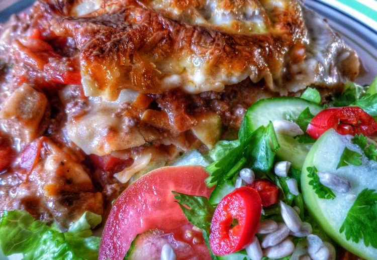 A plate of comfort Chilli Close-up Comfort Composition Corriander Culture Food Food And Drink Freshness Healthy Eating Healthy Lifestyle Homemade Indoors  Indulgence Lasagne Meal No People Plate Preparation  Ready-to-eat Side Salad Still Life Table Temptation Vegetable