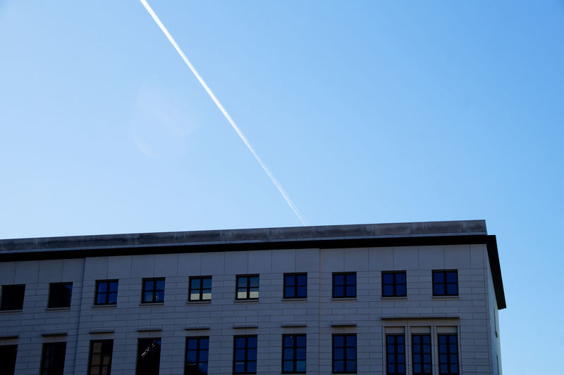 Architecture Art Is Everywhere Blue Building Exterior Built Structure Clear Sky Contrail Day EyeEm Diversity Long Goodbye Low Angle View Nature No People Outdoors Resist Sky The Secret Spaces Vapor Trail