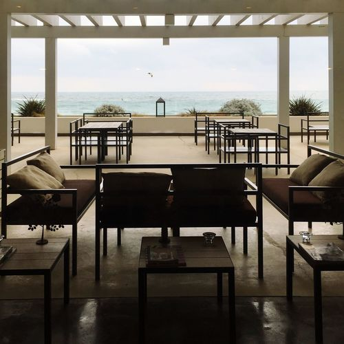 Chair Sea Table Empty Horizon Over Water Luxury Absence Water Indoors  Relaxation Furniture Seat No People Day Sea View Seascape Seaside Sea And Sky Outdoor Photography Luxury Hotel Built Structure Sky Nature Architecture Beauty In Nature