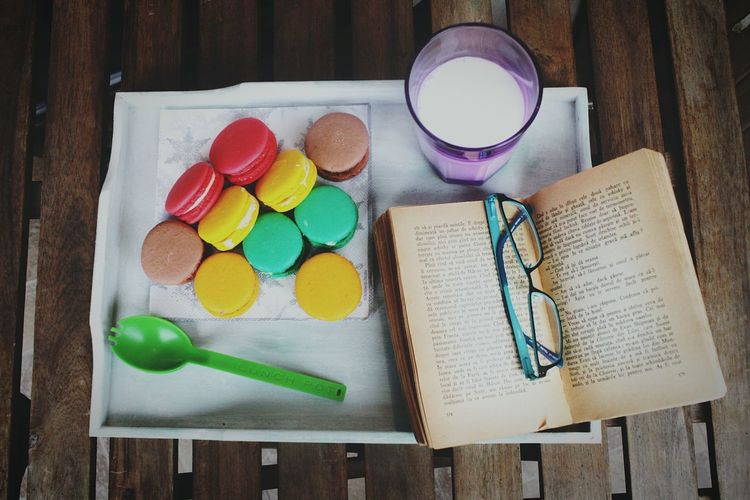 Multi Colored Food Photography Macarons Read Book Enjoying Life Enjoy Free Day😂🙈 Good Times Good Book Reading Serving Food Desert Beauty Desert Macarons Lover Milk Food Stock Photo Stock Photography Daylylife Food Colors 10