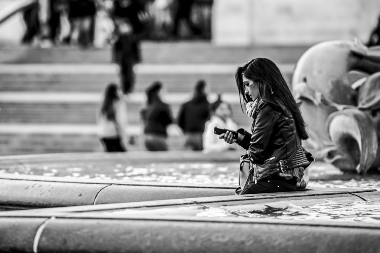 """""""Please Call"""" Black & White Black And White Blackandwhite Casual Clothing City Life Focus On Foreground Lifestyles London Looking Motion Person Photography Woman Women Around The World The Street Photographer - 2017 EyeEm Awards The Portraitist - 2017 EyeEm Awards My Best Photo"""