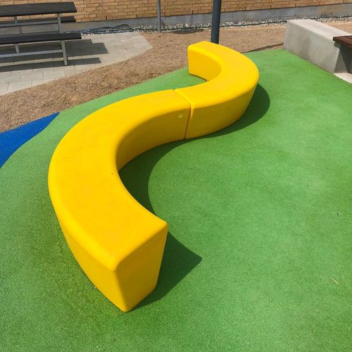 High angle view of yellow slide in park