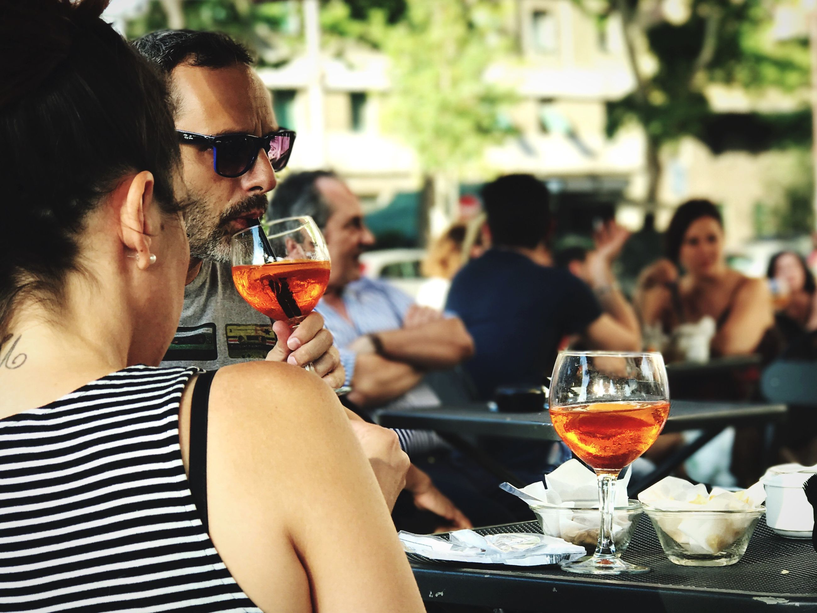 drink, wine, wineglass, drinking, food and drink, restaurant, table, alcohol, men, friendship, togetherness, drinking glass, women, sitting, food, outdoors, day, adult, people